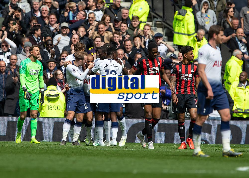 Football - 2018 / 2019 Premier League - Tottenham Hotspur vs. Huddersfield Town<br /> <br /> Spurs players congratulate goalscorer Lucas Moura (Tottenham FC)  as Huddersfield Town players trudge back at The Tottenham Hotspur Stadium.<br /> <br /> COLORSPORT/DANIEL BEARHAM