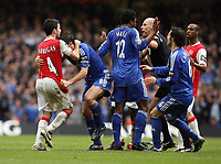 Photo: Rich Eaton.<br /> <br /> Chelsea v Arsenal. Carling Cup Final. 25/02/2007. Cesc Fabregas left of Arsenal and Frank Lampard centre of Chelsea wrestle as referee Howard Webb moves in to try and break them apart