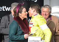 National Hunt Horse Racing - 2020 Cheltenham Festival - Wednesday, Day Two (Ladies Day)<br /> <br /> Katie Walsh congratulates the Winner, Harry Skelton on Politologue in the 15.30 Betway Queen Mother Champion Steeple chase (Grade 1), at Cheltenham Racecourse.<br /> <br /> COLORSPORT/ANDREW COWIE