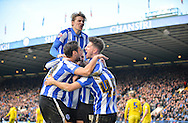 Sheffield Wednesday players celebrate after Sheffield Wednesday Forward Gary Hooper opens the scoring during the Sky Bet Championship match between Sheffield Wednesday and Leeds United at Hillsborough, Sheffield, England on 16 January 2016. Photo by Adam Rivers.