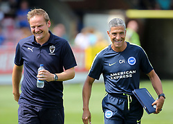 Brighton Manager Chris Hughton (right) shares a joke with Wimbledon Manager Neal Ardley before kick off during a pre season friendly match at The Cherry Red Records Stadium, Kingston Upon Thames.