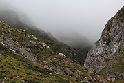 Hiking in the fog up from the hamlet of Beges, on the eastern side of the Picos de Europa national park in northern Spain