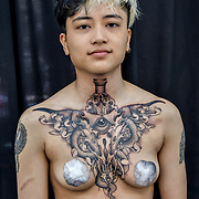 William Jones  - Tattoo Artist show his finish work of a client at The Great British Tattoo Show, on 26 May 2019, London, UK.