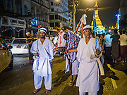 23 OCTOBER 2015 - YANGON, MYANMAR: A riderless horse leads an Ashura procession at Mogul Mosque in Yangon. Ashura commemorates the death of Hussein ibn Ali, the grandson of the Prophet Muhammed, in the 7th century. Hussein ibn Ali is considered by Shia Muslims to be the third imam and the rightful successor of Muhammed. He was killed at the Battle of Karbala in 610 CE on the 10th day of Muharram, the first month of the Islamic calendar. According to Myanmar government statistics, only about 4% of the population is Muslim. Many Muslims have fled Myanmar in recent years because of violence directed against Burmese Muslims by Buddhist nationalists. PHOTO BY JACK KURTZ