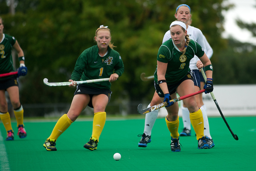 Catamounts forward Colleen Slaughter (9) and Catamounts forward Ashley McDonald (1) in action during the women's field hockey game between the Maine Black Bears and the Vermont Catamounts at Moulton/Winder Field on Saturday afternoon September 29, 2012 in Burlington, Vermont.