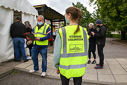 © Licensed to London News Pictures. 23/05/2021. London, UK. Covid-19 volunteers outside a vaccination centre in Tottenham, north London. A Public Health England study has revealed that both the Pfizer and AstraZeneca jabs are effective against the Indian Covid-19 variant, after both doses.  Photo credit: Dinendra Haria/LNP
