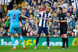 Steven Reid (IRL) of West Brom argues with the referee as Younes Kaboul (FRA) of Tottenham Hotspur walks away - Photo mandatory by-line: Rogan Thomson/JMP - 07966 386802 - 12/04/2014 - SPORT - FOOTBALL - The Hawthorns Stadium - West Bromwich Albion v Tottenham Hotspur - Barclays Premier League.