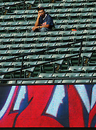 MORNING JOURNAL/DAVID RICHARD<br />A lone fan sits alone in a near-empty second level of Jacobs Field after the Indians were eliminated from the playoffs after a 3-1 loss to Chicago yesterday.