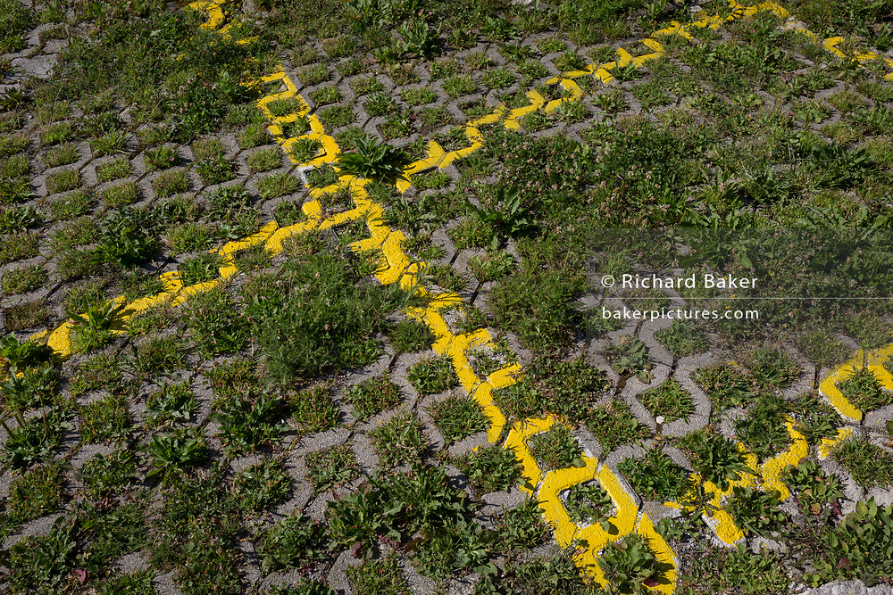 Yellow lines sprayed to mark car parking areas in a rural Slovenian village, on 18th June 2018, in Bohinjska Bela, Bled, Slovenia.