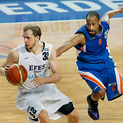 Efes Pilsen's Sinan GULER (L) and Mersin BSB's Alex SCALES (R) during their Turkish Basketball league match Efes Pilsen between Mersin BSB at the Sinan Erdem Arena in Istanbul Turkey on Saturday 19 March 2011. Photo by TURKPIX