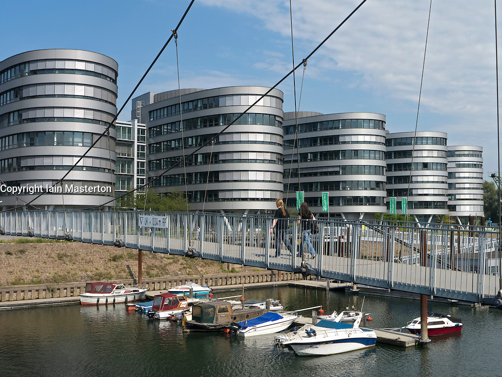 Modern footbridge and office buildings at Innenhafen area of Duisburg in North Rhine-Westphalia Germany