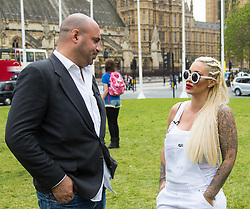 "Westminster, London, May 24th 2016. Animal rights protesters from ""Boycott Dogs4Us"" protest outside Parliament against puppy farming and third party puppy selling as the Environment, Food and Rural Affairs Sub-Committee are investigating the sale of dogs as part of their animal welfare inquiry. PICTURED: TV Vet Marc Abraham and Jodie Marsh"