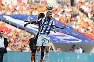 Daniel Pudil of Sheffield Wednesday heads the ball over Tom Huddlestone of Hull City. Skybet football league Championship play off final match, Hull city v Sheffield Wednesday at Wembley Stadium in London on Saturday 28th May 2016.<br /> pic by John Patrick Fletcher, Andrew Orchard sports photography.