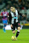 Miguel Almiron (#24) of Newcastle United dribbles the ball forward during the Premier League match between Newcastle United and Crystal Palace at St. James's Park, Newcastle, England on 21 December 2019.