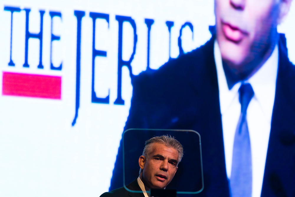Israeli Member of the Parliament and leader of the Yesh Atid party, Yair Lapid addresses the Jerusalem Post Diplomats Conference in Jerusalem, Israel, on December 11, 2014.