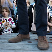 CHARLESTON SC - MARCH 22: A young person listens to  Democratic presidential candidate, Beto O'Rourke,  speak on a wooden table at a meet and greet outside of Tradesman Brewing Company in Charleston, SC on March, 22, 2019. (Logan Cyrus for The New York Times)