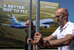 June 18, 2017 - Paris, Le Bourget, France - Visitors walk near the Boeing-777 image one day before the official opening of the 52nd Paris International Airshow in Le Bourget near Paris, France  (Credit Image: © Russian Look via ZUMA Wire)