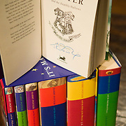 A set of signed Harry Potter books that are being auctioned to raise money for Portobello Rugby Club after it was burnt down by vandals.  Sunday January 13, 2008. Lyon and Turnbull auctioneers are to sell a set of signed Harry Potter books, donated by JK Rowling to rebuild Portobello Rugby Club after it was burnt down vandals in May 2007. The books, worth over £3000 are all singed by J K Rowling and were given in personally to the Rugby Club to help with fund-raising for the new club house. The set will be auction on Wednesday the 16th of January