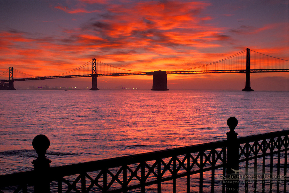 Suspension span of the Bay Bridge at sunrise, from Rincon Park on the Embarcadero, San Francisco, California
