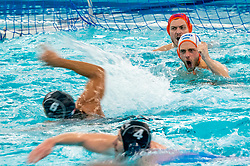 Eelco Wagenaar, Pascal Janssen of the Netherlands in action against Enzo Khasz of France during the Olympic qualifying tournament. The Dutch water polo players are on the hunt for a starting ticket for the Olympic Games on February 17, 2021 in Rotterdam