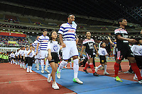 Football - Anton Ferdinand of QPR heads on to the pitch during the friendly match against Kelantan Select XI during the QPR Asian Tour 2012 at the Shah Alam Stadium, Selangor, Malaysia