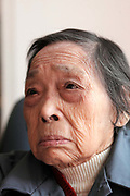 Qiu Jinzhen, who suffers from dementia, photographed at the Shanghai 3rd Welfare House in Shanghai, China on 28 November 2010.  Dementia and Alzheimer's is fast establishing themselves as a major health risk for China's booming elderly population, placing strain on families and society a like, especially in major cities such as Shanghai, where the traditional system of large family and caring for the old by family members give way to small family units and retirement homes.