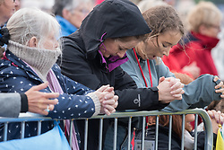 © Licensed to London News Pictures. 26/08/2018. Dublin, Ireland. Crowds pray during the visit of Pope Francis to Phoenix Park Dublin. Pope Francis said mass to an estimated hundred thousand people. Pope Francis is the 266th Catholic Pope and current sovereign of the Vatican. Photo credit: Barry Cronin/LNP