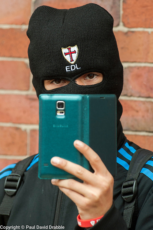 """Rotherham England<br /> 13 September 2014 <br /> EDL supporter films the scenes outside Rotherham Town Hall on his Mobile Phone before the start of the English Defence Leagues Justice for the Rotherham 1400 March on Saturday Afternoon described by an EDL Facebook Page as """"a protest against the Pakistani Muslim grooming gangs"""" on Saturday Afternoon <br /> <br /> <br /> Image © Paul David Drabble <br /> www.pauldaviddrabble.co.uk"""