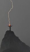 Rio de Janiero, Brazil - The 130-foot tall Christ the Redeemer statue (Corcovado) was struck by lightning in Rio de Janeiro, Brazil, during a Sunday thunderstorm. The strike made for a pretty amazing photograph. Thankfully, the monument suffered only minimal damage as a result of the jolt. Back in July, Christ the Redeemer was named one of the New Seven Wonders of the World, and it inspires millions of visits from tourists and religious pilgrims per year.   <br /> ©ZP/Exclusivepix