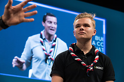 © Licensed to London News Pictures  . 03/10/2017 . Manchester , UK . JACK from South Shields listens as Chief Scout BEAR GRYLLS speaks on stage ahead of the Home Secretary , during day three of the Conservative Party Conference at the Manchester Central Convention Centre . Photo credit : Joel Goodman/LNP