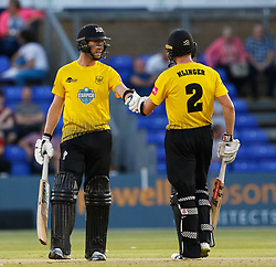 Gloucestershire's Michael Klinger with team-mate Ian Cockbain celebrates a boundary<br /> <br /> Photographer Simon King/Replay Images<br /> <br /> Vitality Blast T20 - Round 8 - Glamorgan v Gloucestershire - Friday 3rd August 2018 - Sophia Gardens - Cardiff<br /> <br /> World Copyright © Replay Images . All rights reserved. info@replayimages.co.uk - http://replayimages.co.uk