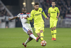 February 19, 2019 - Lyon, França - LYON, LY - 19.02.2019: LYON X BARCELONA - Lionel Messi of Barcelona and Ndombele of Lyon during the match between Lyon and Barcelona held at Parc Olympique Lyonnais in Lyon. The match is valid for the octaves of the Champions League 2018/2019. (Credit Image: © Richard Callis/Fotoarena via ZUMA Press)