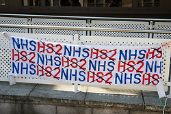A banner draped over a railing by supporters of seven environmental activists from HS2 Rebellion attending a hearing at High Wycombe Magistrates Court is pictured on 10th August 2020 in High Wycombe, United Kingdom. The activists, who are predominantly teenage and who are opposed to the controversial HS2 high-speed rail link, had been arrested whilst standing on a bridge on a public footpath in Denham Country Park by police officers using the Trade Union and Labour Relations Act.