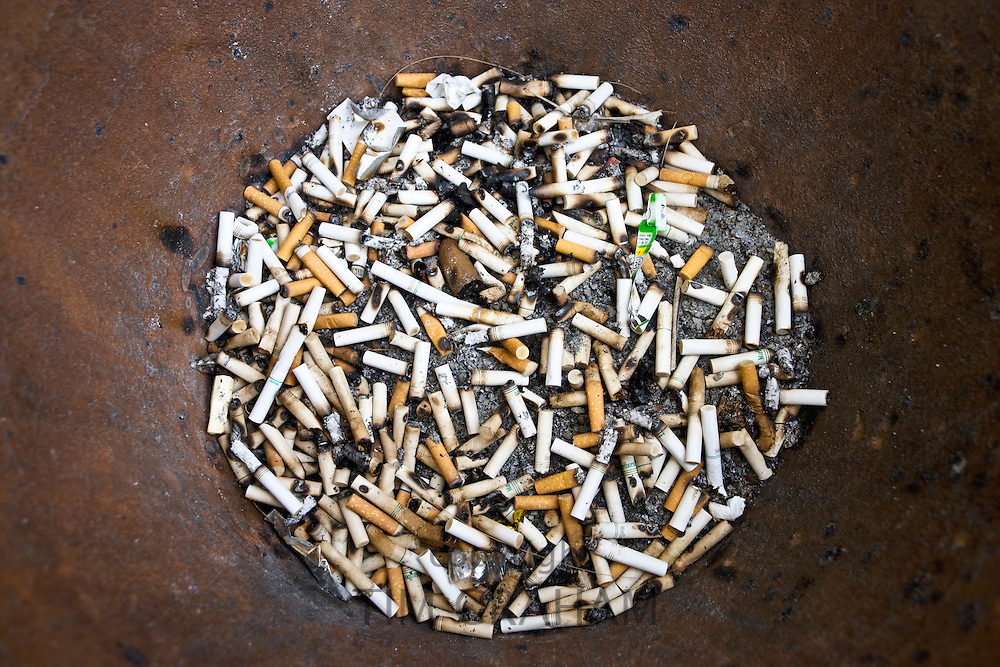 No Smoking rules mean smokers have to discard cigarette and cigar butts outside a cafeteria and shop, Florida, USA
