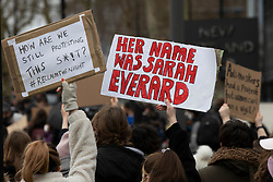© Licensed to London News Pictures. 14/03/2021. London, UK. Activists hold a placards outside New Scotland Yard during a protest against the Police, Crime, Sentencing and Courts Bill 2021 that if passed will introduce new restrictions on protest. This demonstration comes after police arrested attendees at a vigil for Sarah Everard on Clapham Common last night.  Photo credit: George Cracknell Wright/LNP
