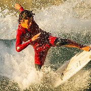 A surfer rides a wave near the Huntington Beach Pier on November 7, 2014 in Huntington Beach, CA. (Photo by Ben Jackson)