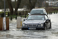 © Licensed to London News Pictures. 01/08/2014. Car on flooded Chertsey Bridge Road. Recent bad weather has caused the river Thames in south west London and Surrey to reach very high levels. Credit : Rob Powell/LNP