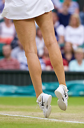 28.06.2014, All England Lawn Tennis Club, London, ENG, WTA Tour, Wimbledon, im Bild The long legs of Maria Sharapova (RUS) during her Ladies' Singles 3rd Round victory 6-3, 6-0 on day six // 15065000 during the Wimbledon Championships at the All England Lawn Tennis Club in London, Great Britain on 2014/06/28. EXPA Pictures © 2014, PhotoCredit: EXPA/ Propagandaphoto/ David Rawcliffe<br /> <br /> *****ATTENTION - OUT of ENG, GBR*****