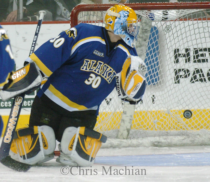 03 Nov 2006 Omaha NE t University of Alaska goalie Chad Johnson  can only watch the Brandon Scero shot during the second period to make it 2-3 Alaska  at the Qwest Center Omaha Friday night.(photo by Chris Machian/Prairie Pixel Group)<br />
