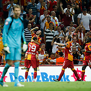 Galatasaray's players (L-R) Emre Colak, Umut Bulut, Tomas Ujfalusi, Emmanuel Eboue celebrating his goal and Kasimpasa's goalkeeper Andreas Isaksson (L) during their Turkish Super League soccer match Galatasaray between Kasimpasa at the TT Arena at Seyrantepe in Istanbul Turkey on Monday 20 August 2012. Photo by TURKPIX