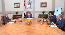June 17, 2017 - Cairo, Cairo, Egypt - Egyptian President Abdel Fattah al-Sisi meets with Prime Minister Sharif Ismail and Minister of Higher Education Khalid Abdul Ghaffar, in Cairo, Egypt, on June 17, 2017  (Credit Image: © Egyptian President Office/APA Images via ZUMA Wire)