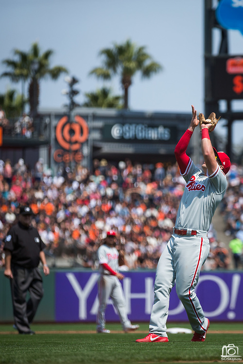 Philadelphia Phillies first baseman Rhys Hoskins (17) tracks down a San Francisco Giants pop fly at AT&T Park in San Francisco, California, on August 20, 2017. (Stan Olszewski/Special to S.F. Examiner)