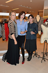 Left to right, BAY GARNETT, JASMINE GUINNESS and PEARL LOWE at the launch of the 'Jasmine for Jaeger' fashion collection by Jasmine Guinness for fashion label Jaeger held at Fenwick's, Bond Street, London on 9th September 2015.