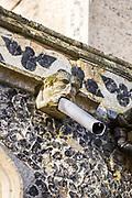 Church of Saint Mary of the Assumption, Ufford, Suffolk, England, UK gargoyle drain pipe on outside wall