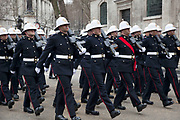 London Wednesday 17th April 2013. The funeral of former Prime Minister Baroness Margaret Thatcher. Members of the Marines armed forces parade past St Clement Danes Church prior to the funeral procession.