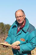 Bernard Bellahsen. Domaine Fontedicto, Caux. Pezenas region. Languedoc. Fossilised oysters in the calcareous soil. Terroir soil. Owner winemaker. France. Europe. Calcareous limestone.
