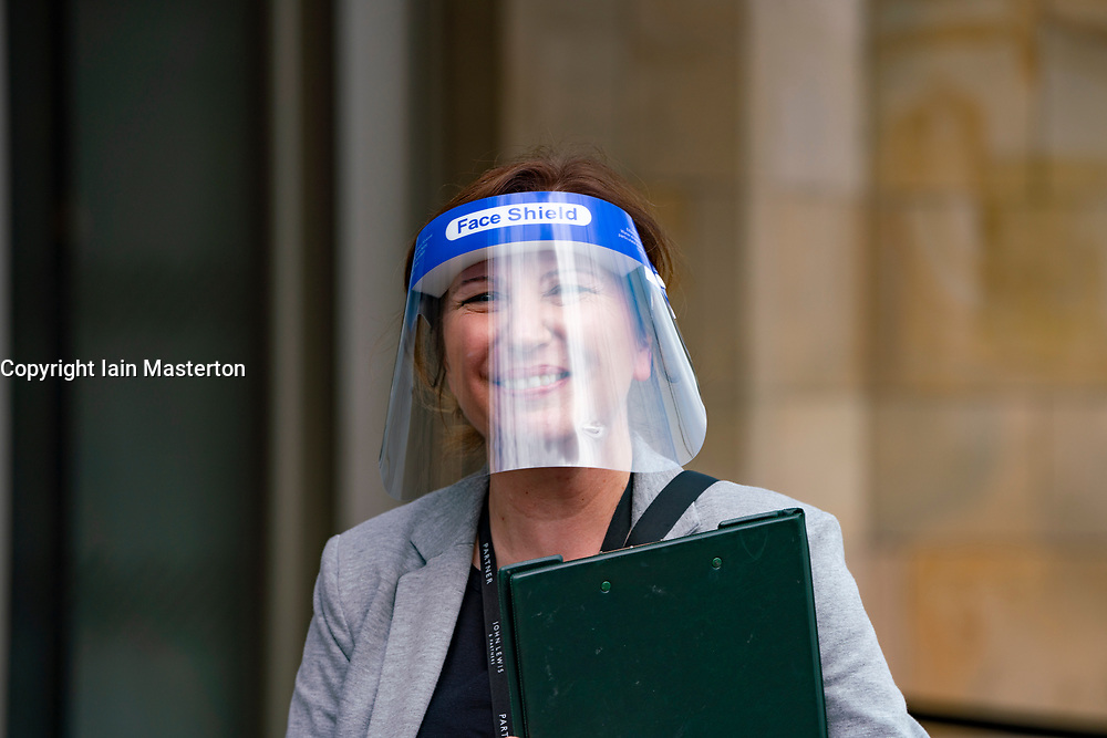 Edinburgh, Scotland, UK. 13 July, 2020, Monday in Scotland saw re-opening of shopping centres after further relaxation of coronavirus lockdown on business. John Lewis & Partners department store opened early at 9.30 am after a long queue had formed outside. Staff were wearing PPE and many have face shields .Iain Masterton/Alamy Live News