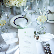 An elegant place setting at American Yahct Club using lots of whites.