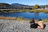 The Togetsukyo Bridge is a famous landmark in Arashiyama. The Hozu River, over which the bridge is built, is a favorite spot in Kyoto for river boat rides and viewing the autumn foliage.  The Katsura River is a continuation of the Hozu River on either side of the bridge.
