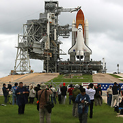 Members of the media take photos of the shuttle Atlantis as it sits on the pad after the rotating service structure is peeled away at the Kennedy Space Center Thursday, July 7, 2011, in Cape Canaveral, Fla. (AP Photo/Alex Menendez)